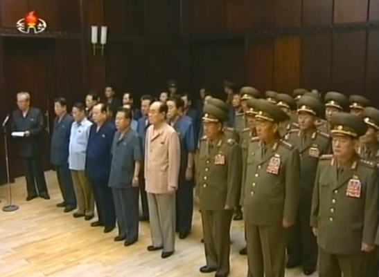Members of Jon Pyong Ho's national funeral committee on 10 July 2014 in the front row (L-R): Kim Ki Nam (at microphone), Ro Tu Chol; Kang Sok Ju; Pak To Chun; Choe Ryong Hae; Kim Yong Nam; VMar Hwang Pyong So; Gen. Hyon Yong Chol; Gen. Kim Wo'n-hong (Photo: KCTV).