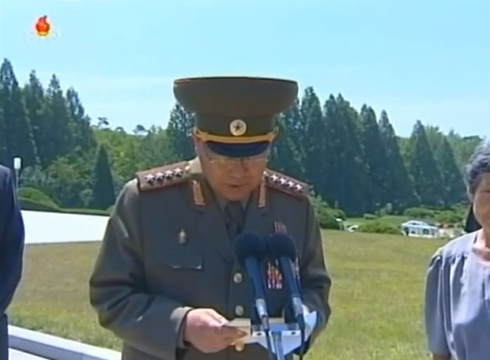Minister of the People's Armed Forces Gen. Hyon Yong Chol delivers a eulogy at a burial ceremony for Jon Pyong Ho on 10 July 2014 (Photo: KCTV).