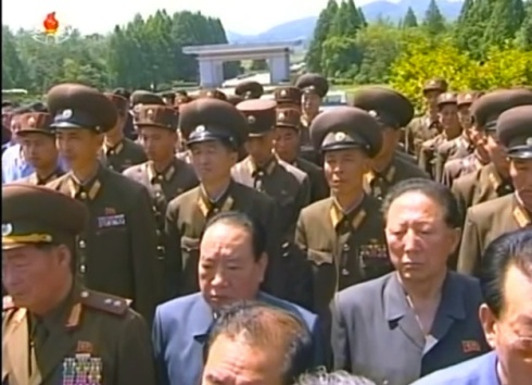 Senior officials of the DPRK's military industrial complex attend a burial ceremony for Jon Pyong Ho at Patriotic Martyrs' Cemetery in Ryongso'ng District, Pyongyang, on 10 July 2014.  Among those in attendance is Hong Sung Mu (right) (Photo: KCTV).