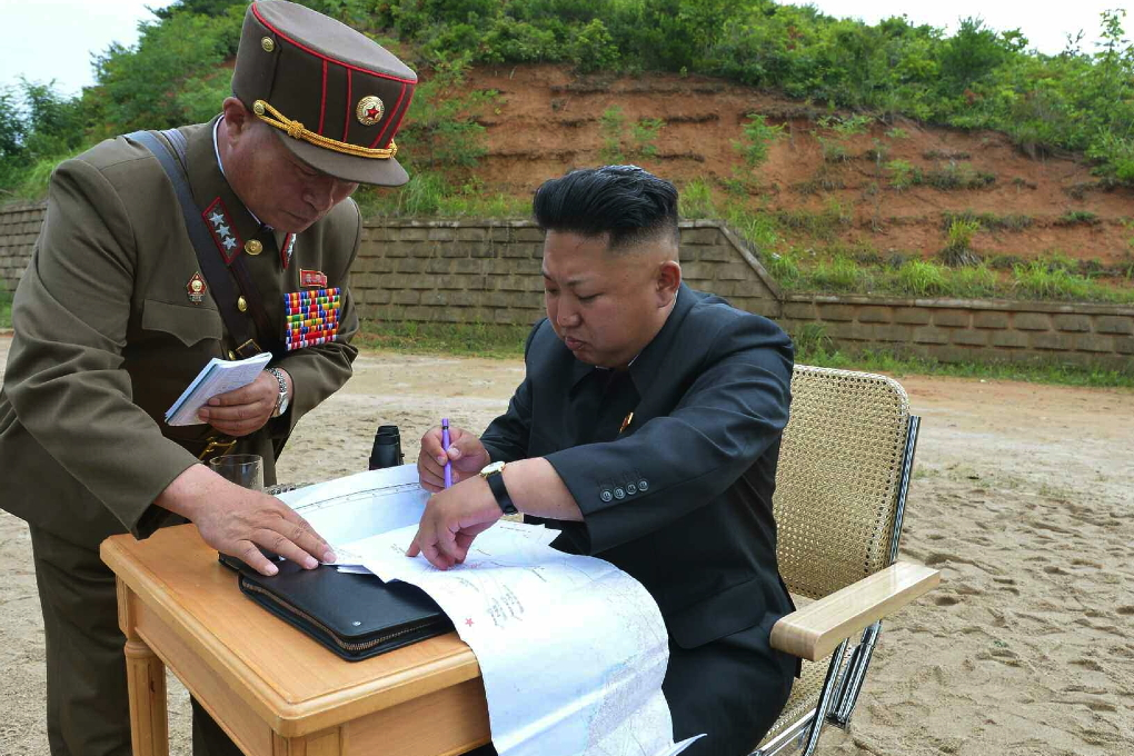Kim Jong Un reviews plans for an island landing drill conducted by the three service branches of the KPA.  Also in attendance is Col. Gen. Pak Jong Chon, Vice Chief of the KPA General Staff (Photo: Rodong Sinmun).