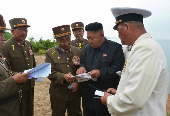 Kim Jong Un confers with members of the KPA high command during an island landing drill.  Seen in attendance are VMar Hyong Pyong So (1), Director of the KPA General Political Department, Gen. Pyon In Son (2), Director of the KPA General Staff Operations Bureau, and Gen. Ri Yong Gil (3), Chief of the KPA General Staff (Photo: Rodong Sinmun).