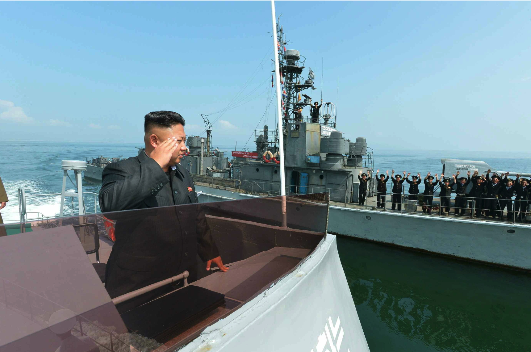 Kim Jong Un salutes KPA Navy service members from a warship following an island landing drill (Photo: Rodong Sinmun).