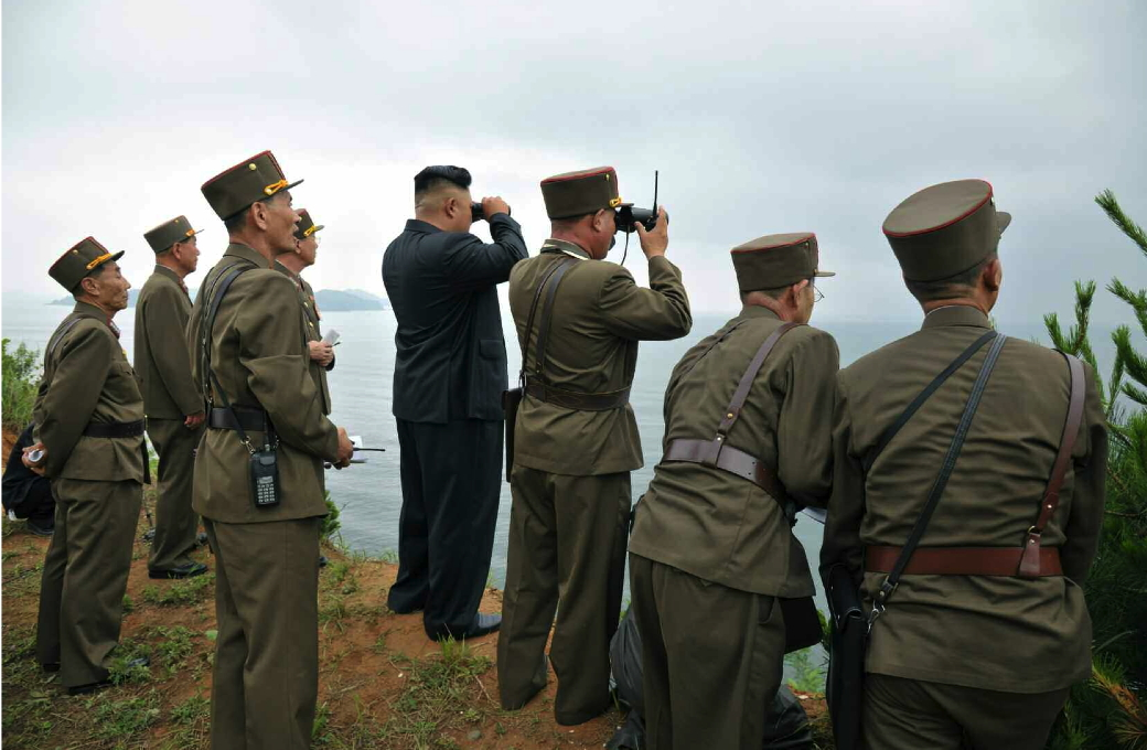 Kim Jong Un and senior KPA officials watch an island landing drill (Photo: Rodong Sinmun).