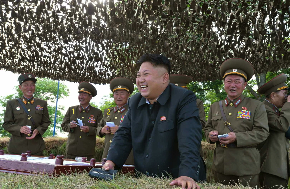 Kim Jong Un at a field inspection of the Hwa Islet Defense Detachment.  Also in attendance are KPA General Political Department Director Hwang Pyong So (1) and a Vice Chief of the KPA General Staff Col. Gen. Pak Jong Chon (2) (Photo: Rodong Sinmun).