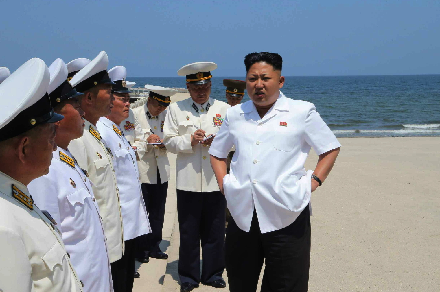 Kim Jong Un talks with KPA Navy commanding officers prior to an assessment of their swimming abilities (Photo: Rodong Sinmun).