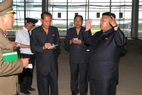 Kim Jong Un talks with civil aviation officials during a tour of the construction of a terminal at Pyongyang Airport (Photo: Rodong Sinmun).