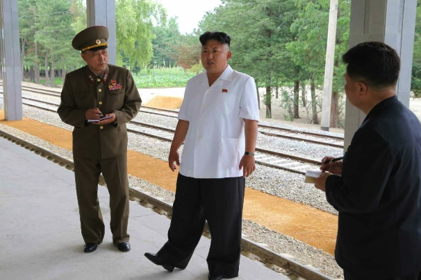 Kim Jong Un tours the construction of Songdowon Railway Station.  Also seen in attendance is Director of the NDC Design Department Ma Won Chun (left) and WPK Finance and Accounting Department Director Han Kwang Sang (right) (Photo: Rodong Sinmun).
