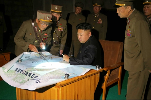 Kim Jong Un is briefed about a rocket drill by the KPA Strategic Forces (Photo: Rodong Sinmun).