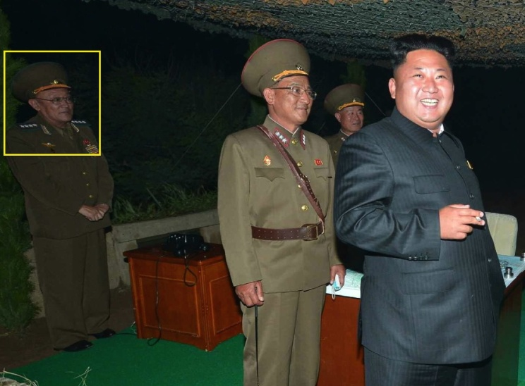 Gen. O Kum Chol attends a a missile launch with Kim Jong Un on 26 July 2014 (Photo: Rodong Sinmun).