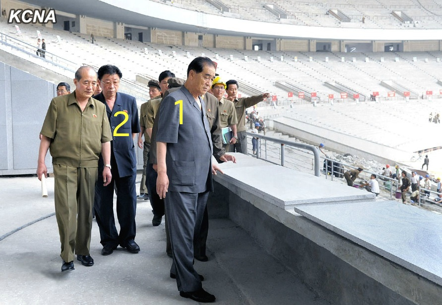 DPRK Premier Pak Pong Ju (1) visits the renovation of the May Day Stadium in Pyongyang.  Also seen in attendance is Ro Tu Chol (2), DPRK Vice Premier and Chairman of the State Planning Commission (Photo: KCNA).