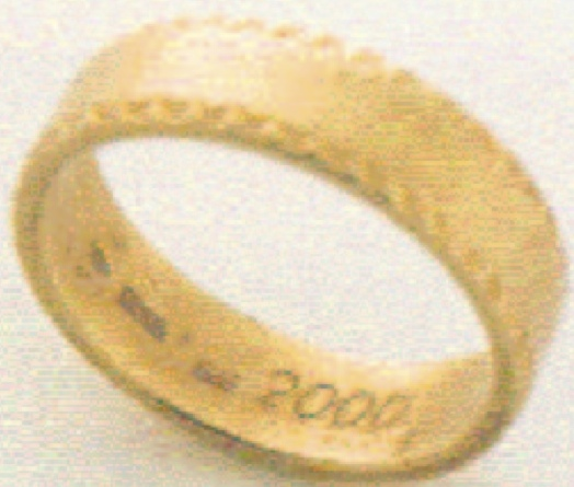 "This gold ring engraved with the year 2000 was presented on January  1, 1990 to Kim Jong Il's former sushi chef and 22 other close aides and staff at a New Year's Day banquet.  In passing out the rings KJI said, ""Putting on this ring, let us greet the year 2000 in 10 years."""