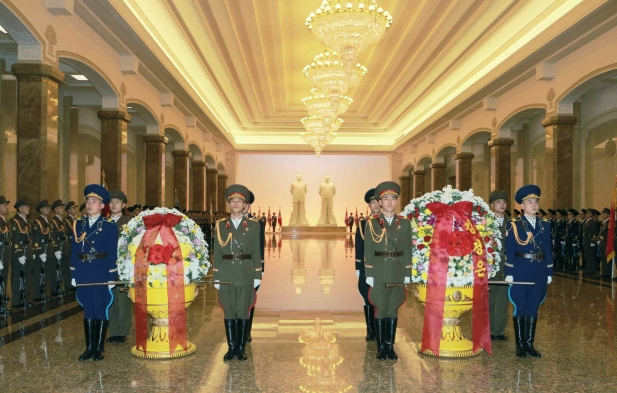 A KPA Honor Guard stands alongside floral baskets from Kim Jong Un (L) and the KPA ( R)  (Photo: Rodong Sinmun).