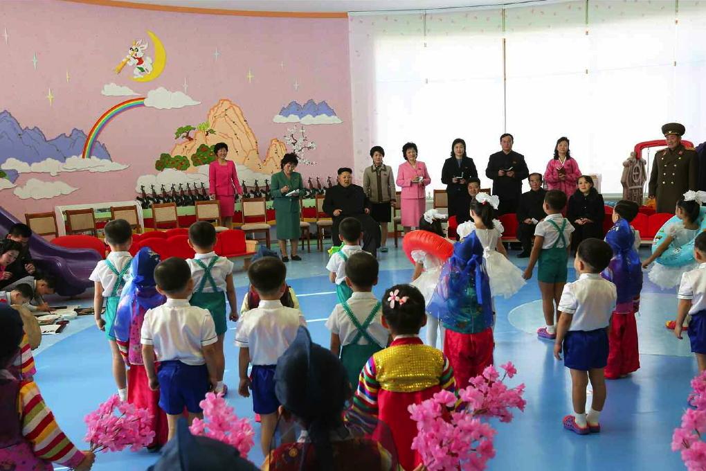 Kim Jong Un and senior DPRK officials watch a performance given by the children living at Pyongyang Baby Home and Orphanage (Photo: Rodong Sinmun).