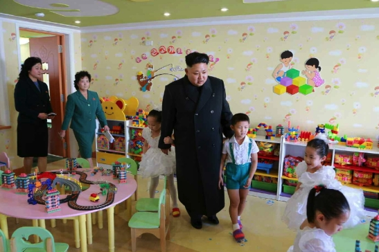 Kim Jong Un walks through a classroom at Pyongyang Baby Home and Orphanage on January 1, 2015 (Photo: Rodong Sinmun).