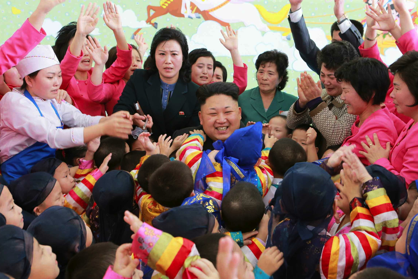 Kim Jong Un greets children residing at Pyongyang Orphanage and Baby Home after posing for commemorative photos with the children and staff on January 1, 2015 (Photo: Rodong Sinmun).