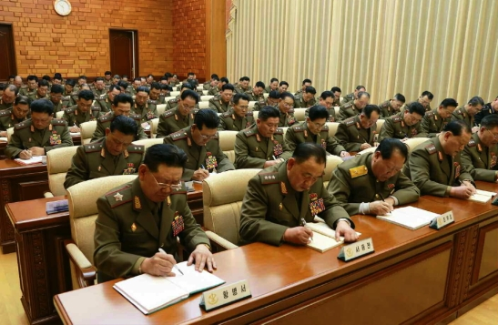 CMC Members and meeting participants take notes (Photo: Rodong Sinmun).