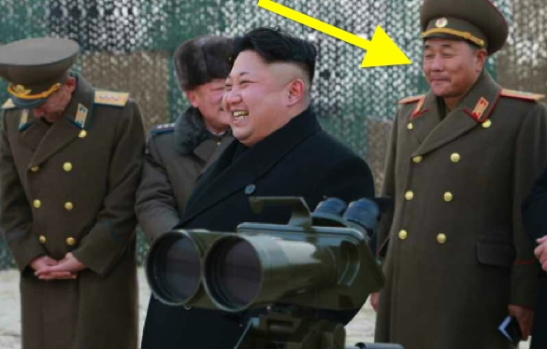 Lt. Gen. Kim Yong Bok (annotated), commander of XI Corps, attends a multiple-launch rocket drill with Kim Jong Un and other members of the KPA high command in late December 2014 (NK Leadership Watch file photo).