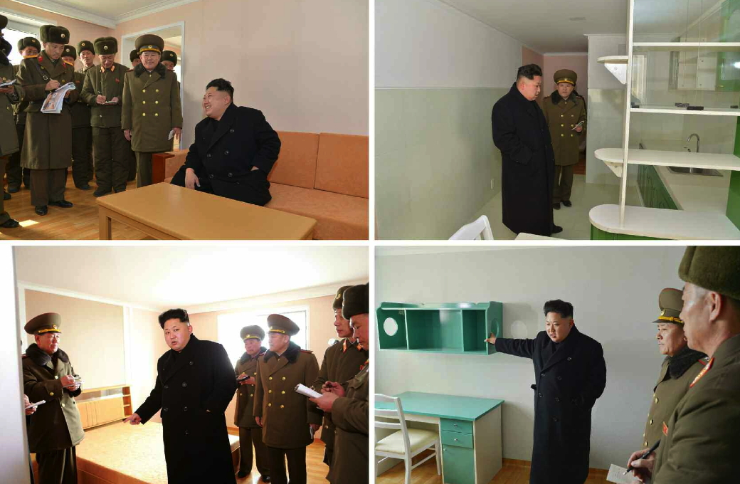 Kim Jong Un tours apartments under construction (Photo: Rodong Sinmun).