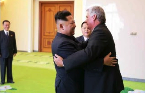 Kim Jong Un greets Cuban Vice President Miguel Díaz-Canel Bermúdez at the Paekhwawon State Guest House in Pyongyang on September 7, 2015.  Also in attendance is WPK Secretary and Director of the United Front Department Kim Yang-ko'n (left) (Photo: Rodong Sinmun).