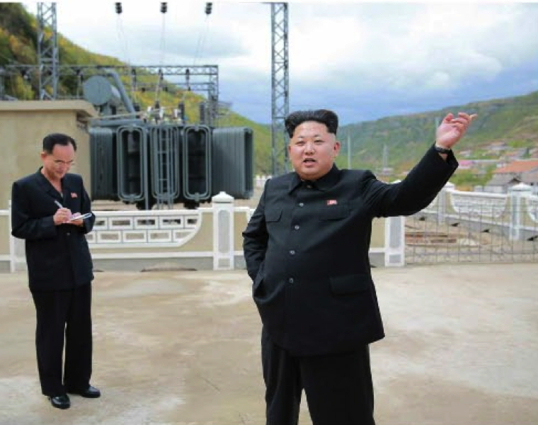 Kim Jong Un at the Paektusan Youth Power Station. Also in attendance is Jo Yong Won (L), deputy director of the WPK Finance and Accounting Department (Photo: Rodong Sinmun).