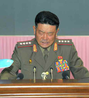 Minister of the People's Armed Forces Gen. Pak Yong Sik reading out a report at a September 10, 2015 meeting to mark the birth anniversary of Ryu Kyong Su (Photo: KCNA).