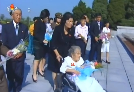 Workers' Party of Korea Central Committee Member Hwang Sun Hui delivers a floral bouquet to the memorial bust of her husband Ryu Kyong Su at the Revolutionary Martyrs' Cemetery in Pyongyang on September 10, 2015 (Photo: KCTV screen grab).