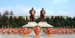 Statues of Kim Il Sung and Kim Jong Il at the center of the campus of the Kim Il Sung University of Politics in Pyongyang.  A floral basket from Kim Jong Un can be seen in the foreground, center (Photo: Rodong Sinmun).