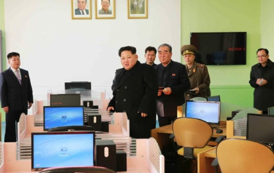 Kim Jong Un looks around a computer room at Mangyo'ngdae Schoolchildren's Palace (Photo: Rodong Sinmun).