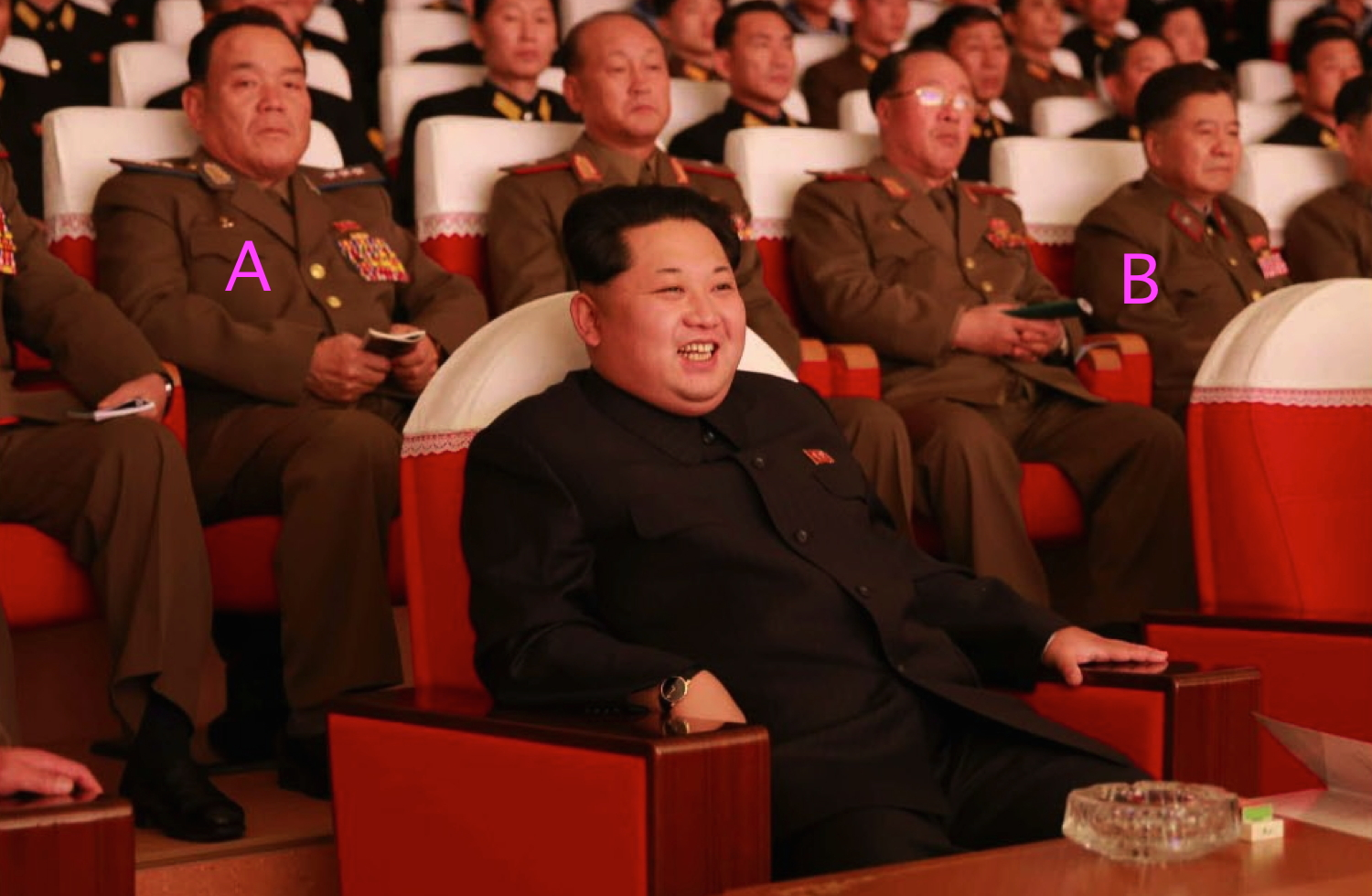 Kim Jong Un watches a concert given by KPA service members. Also in attendance is (A) Col. Gen. Son Chol Ju (deputy director, KPA General Political Department, political director of the KPA Air and Anti-Air Force) and (B) Han Kwang Sang (department director, National Defense Commission) (Photo: Rodong Sinmun).