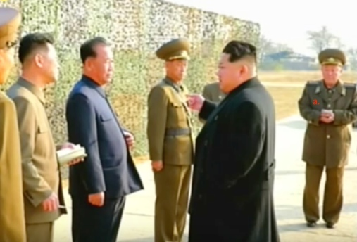 Kim Jong Un arrives at the exercise site.  Also in attendance is Gen. O Kum Chol (a)   (Photo: KCTV screen grab).