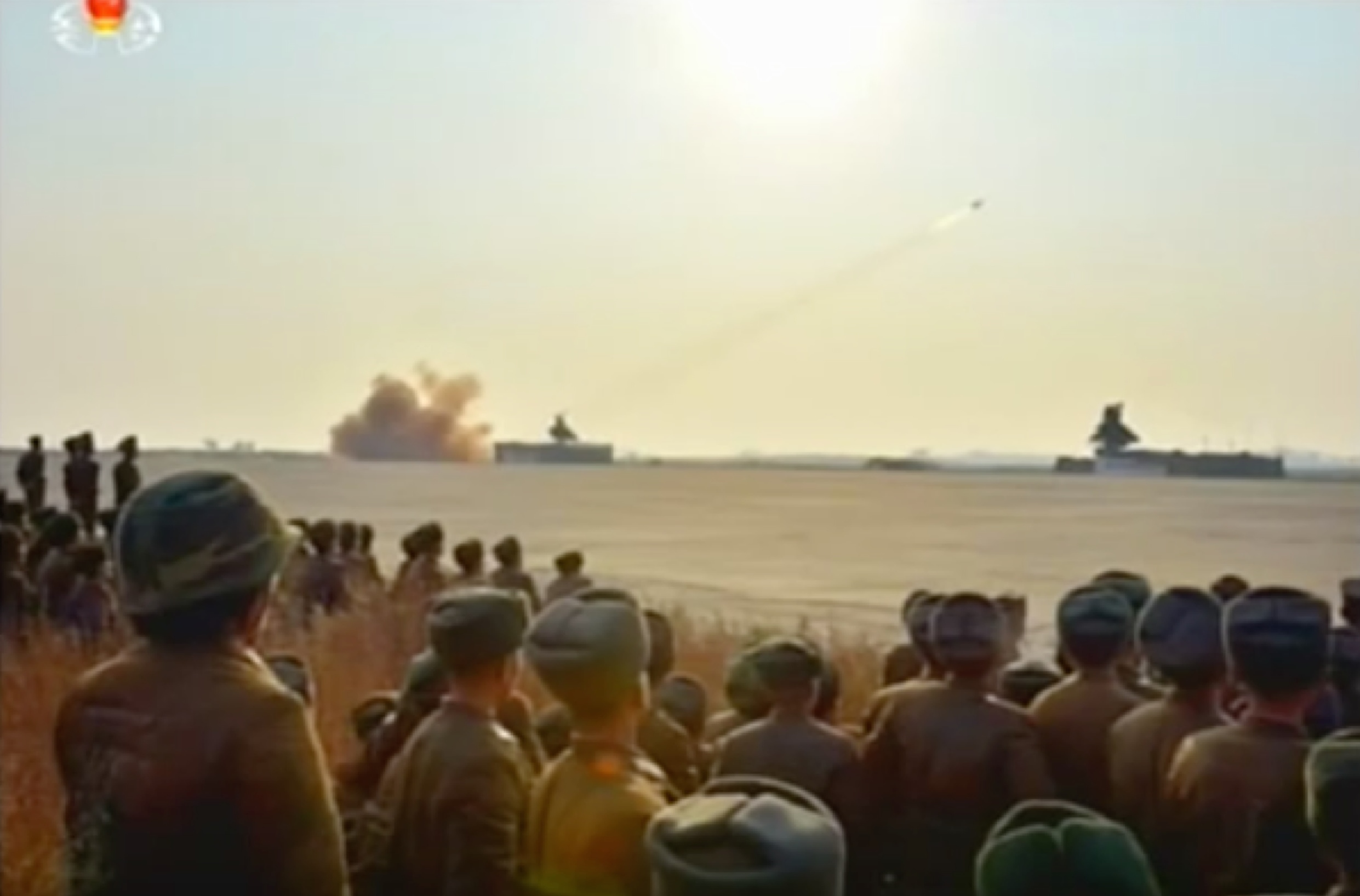 KPA service members and officers observe the anti-air rocket exercise (Photo: KCTV screen grab).