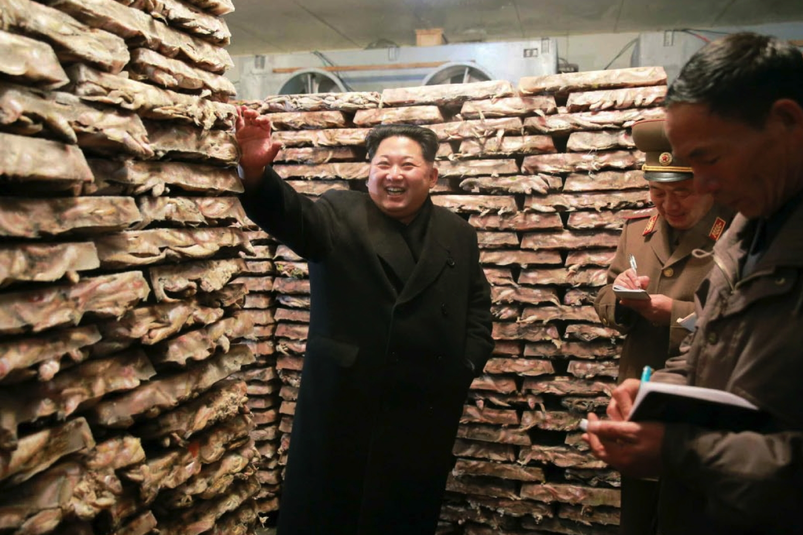 Kim Jong Un looks through a storage facility at Fishery Station #15 which is subordinate to KPA Unit #549.  Also seen in attendance is Col. Gen. So Hong Chang (2nd right) (Photo: Rodong Sinmun).