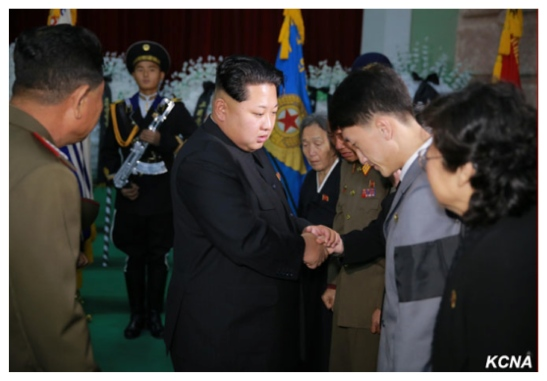 Kim Jong Un greets members of MAR Ri Ul Sol's family after paying his respects to Ri (Photo: KCNA).