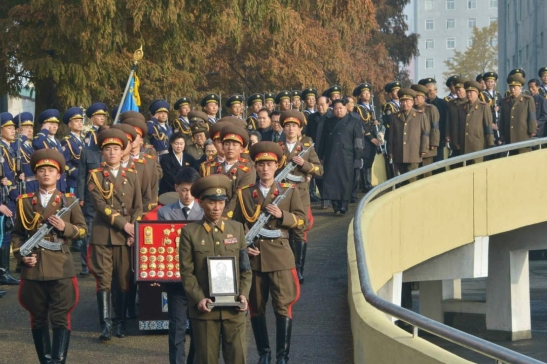 Kim Jong Un leads the state funeral committee out of the Central Hall of Workers in Pyongyang on November 11, 2015, as they process behind the casket of MAR Ri Ul Sol and members of Ri's family (Photo: Rodong Sinmun).