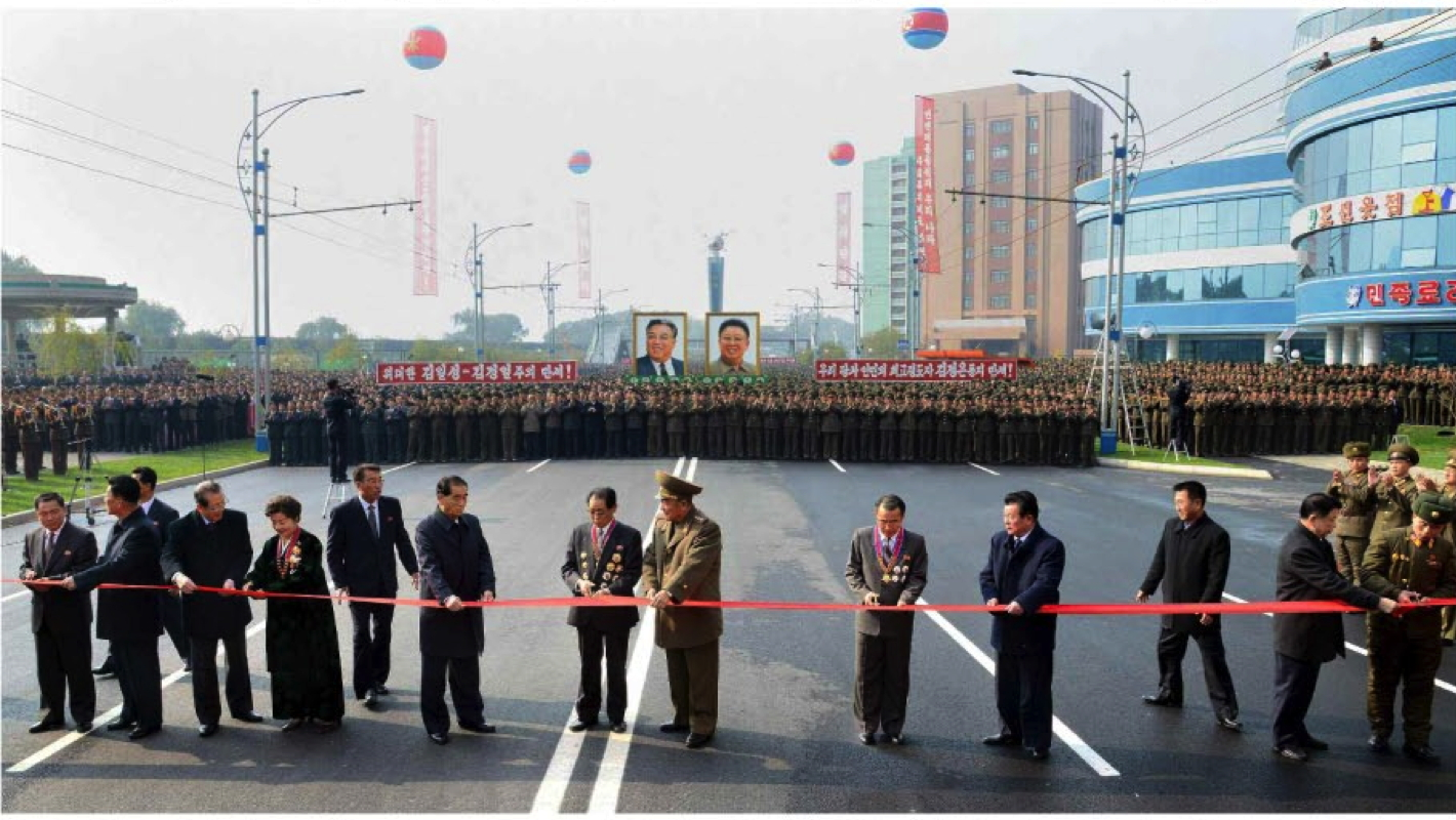 Members of the DPRK's central leadership, construction workers and scientists cuts a ceremonial red tape to open the Mirae Scientists' Street in Pyongyang on November 3 (Photo: Rodong Sinmun).