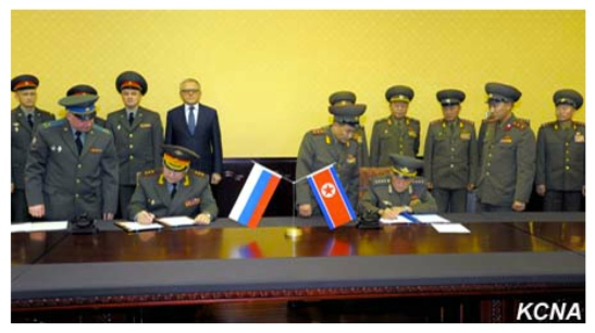 """Russian Federation Armed Forces 1st Vice Chief of the General Staff Col. Gen. Nikolai Bogdanovski (left) and Vice Chief of the KPA General Staff Col. Gen. O Kum Chol (right) sign an agreement on what Russian media said is """"the prevention of dangerous military activity"""" (Photo: KCNA)."""