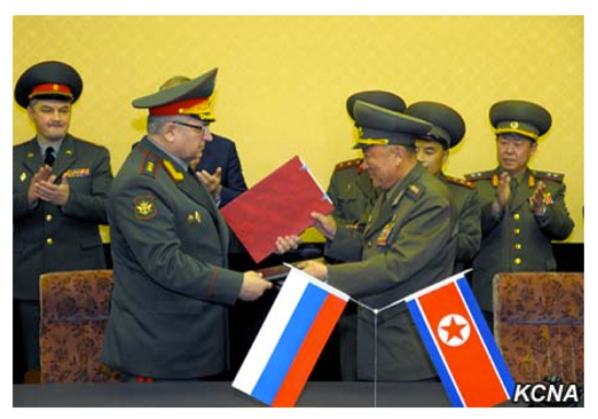 Russian Federation Armed Forces 1st Vice Chief of the General Staff Col. Gen. Nikolai Bogdanovski (left) exchanges an agreement with Vice Chief of the KPA General Staff Col. Gen. O Kum Chol (right) in Pyongyang on November 12, 2015 (Photo: KCNA).