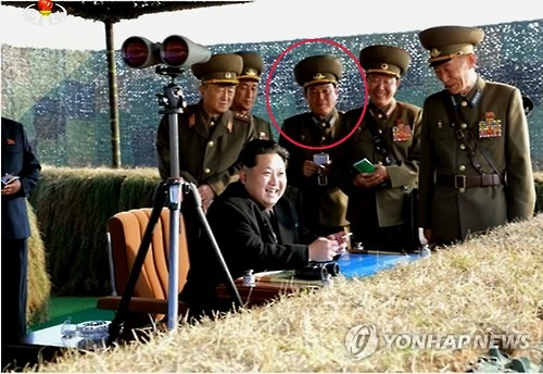KPA Air and Anti-Air Forces Political Director Son Chol Ju (annotated) attends the anti-air exercises. Son has been promoted to Colonel General (three stars; sangjang) from Lieutenant General as indicated by the number of stars on his epaulettes (should boards) (Photo: Yonhap-KCNA).