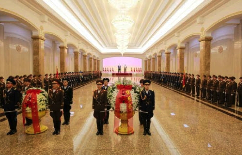 An honor guard of the KPA Ground, Naval and Air Forces and the Worker-Peasant Red Guard with a floral basket from Kim Jong Un at Ku'msusan Palace of the Sun in Pyongyang on December 17, 2015 (Photo: Rodong Sinmun).