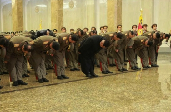 Kim Jong Un and members of the KPA high command bow in front of statues of his father and grandfather in Pyongyang on December 17, 2015 (Photo: Rodong Sinmun).