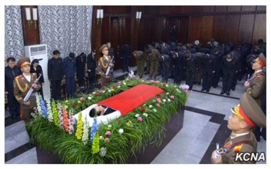 A KPA honor guard stand in attendance at the funeral parlor of WPK Secretary Kim Yang Gon in Pyongyang on December 30, 2015. Also in attendance are members of Kim's family (left) (Photo: KCNA).