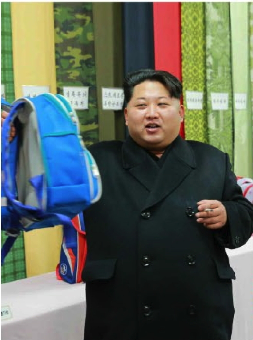 Kim Jong Un examines a backpack manufactured at the Kim Jong Suk Textile Mill (Photo: KCNA/Rodong Sinmun).
