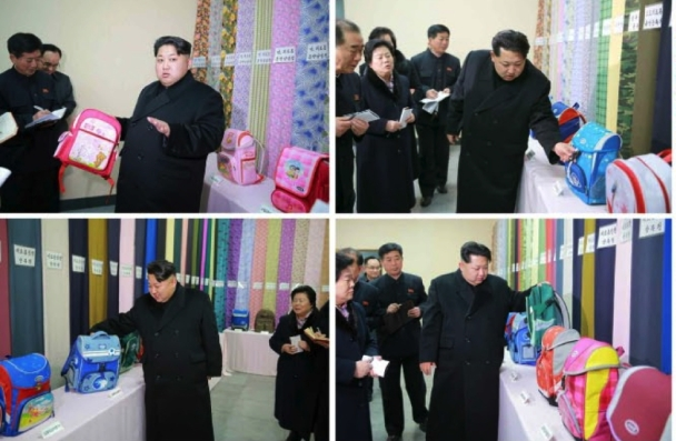 Kim Jong Un looks at schoolbags and other products of the Kim Jong Suk Textile Mill (Photos: KCNA).