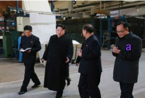 Kim Jong Un tours the Kim Cho'ng-suk Textile Mill in Pyongyang.  Also in attendance is WPK Organization Guidance Department deputy director Jo Yong Won (Photo: Rodong Sinmun).
