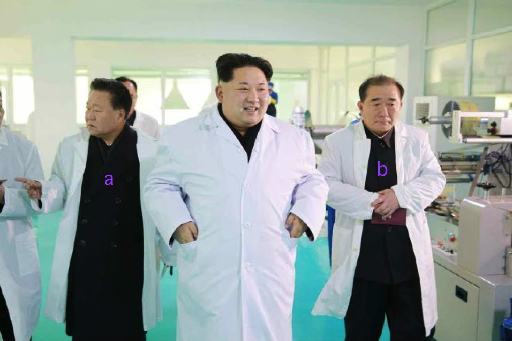 Kim Jong Un tours Kumkop General Foodstuff Factory. Also in attendance are WPK Secretary Choe Ryong Hae (a) and WPK Director of Light Industry An Jong Su (Photo: Rodong Sinmun/KCNA).