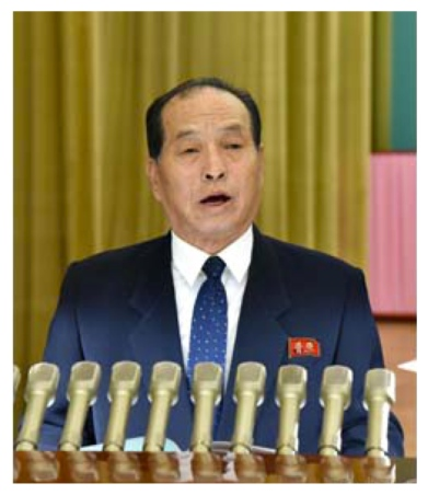 WPK Secretary and director of its Planning and Finance Department Kwak Pom Gi reads a message from the WPK Central Committee to the UAWK's 70th anniversary meeting (Photo: KCNA).