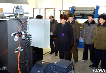 DPRK Premier Pak Pong Ju is briefed about CNC machines during a factory tour (Photo: KCNA).
