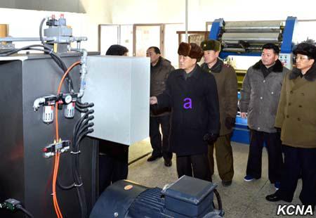 DPRK Premier Pak Pong Ju is briefed about CNC machines during a factory tour (Photo: KCNA).