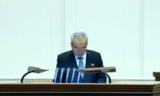 WPK Secretary Kim Ki Nam presides over a February 15, 2016 national meeting commemorating the birth of late DPRK leader Kim Jong Il (Photo: KCTV screen grab).