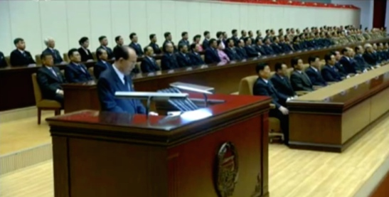 Kim Yong Nam delivers the report at a February 15, 2016 national meeting to mark KJI's birthday (Photo: KCTV screengrab).